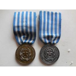 Coppia medaglie al merito di lungo comando nella Guardia di Finanza Zecca
